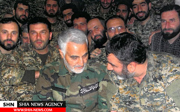 نماز جماعت رزمندگان سپاه مازندران در سوریه + تصویر
