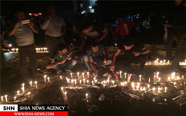 در کربلا به یاد شهدا انفجار اخیر شمع روشن شد + تصاویر