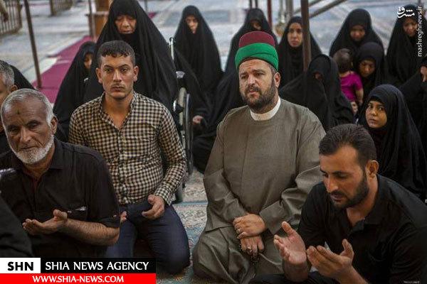 اهدای پرچم حرم حضرت عباس (ع) به پدر پنج شهید مدافع حرم