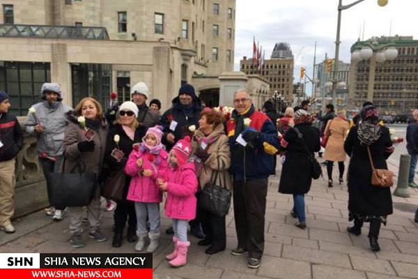 توزیع گل به یاد شهدای کربلا در کانادا+ تصاویر