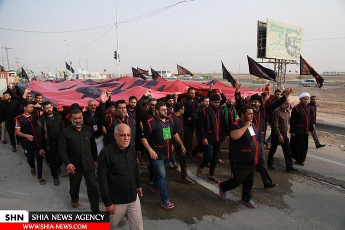 بزرگترین پرچم حسینی در مرز شلمچه به اهتزاز درآمد